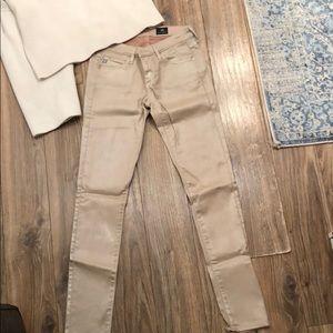 Bone pearlized AG Skinny jeans. Low waisted sz24.
